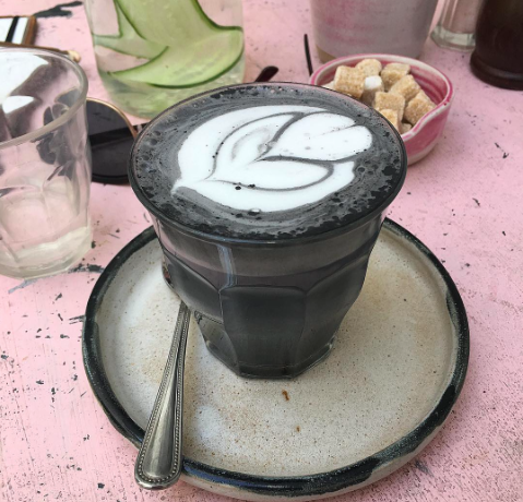 Charcoal lattes are taking over Instagram but is there a downside to the black stuff? [Photo: Instagram/i_am_pavie]