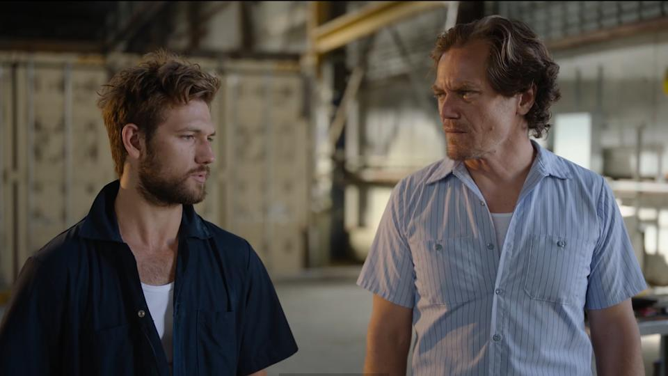 Alex Pettyfer and Michael Shannon in Echo Boomers (Universal)