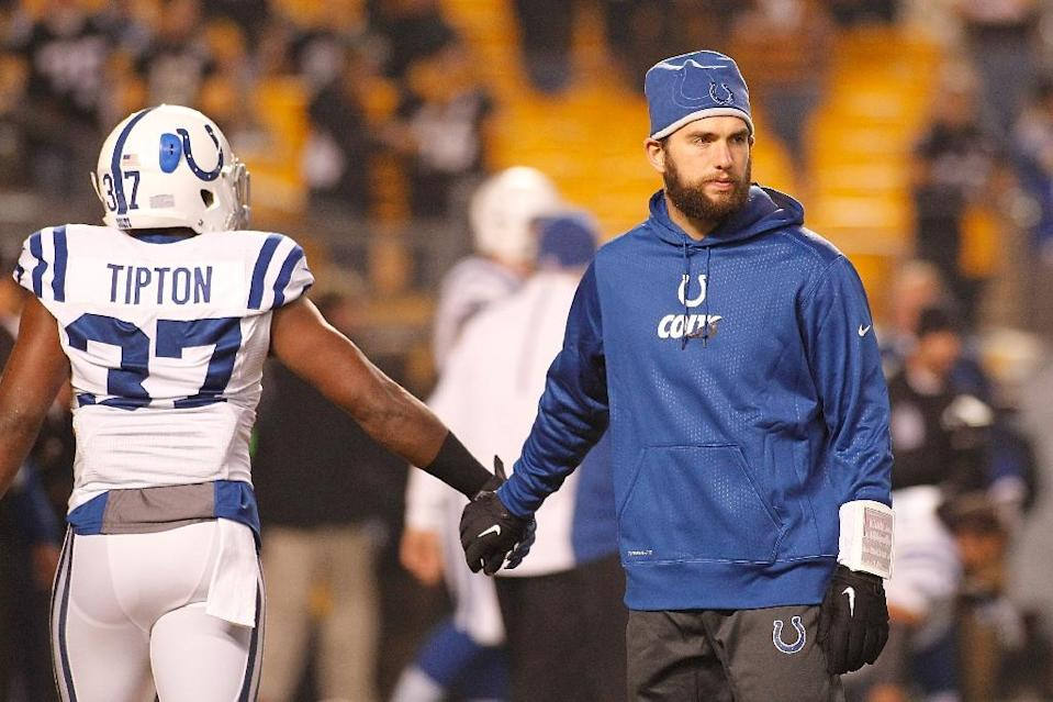 Andrew Luck of the Indianapolis Colts shakes hands with teammate Zurlon Tipton before the start of the game against the Pittsburgh Steelers at Heinz Field on December 6, 2015 (AFP Photo/Justin K. Aller)