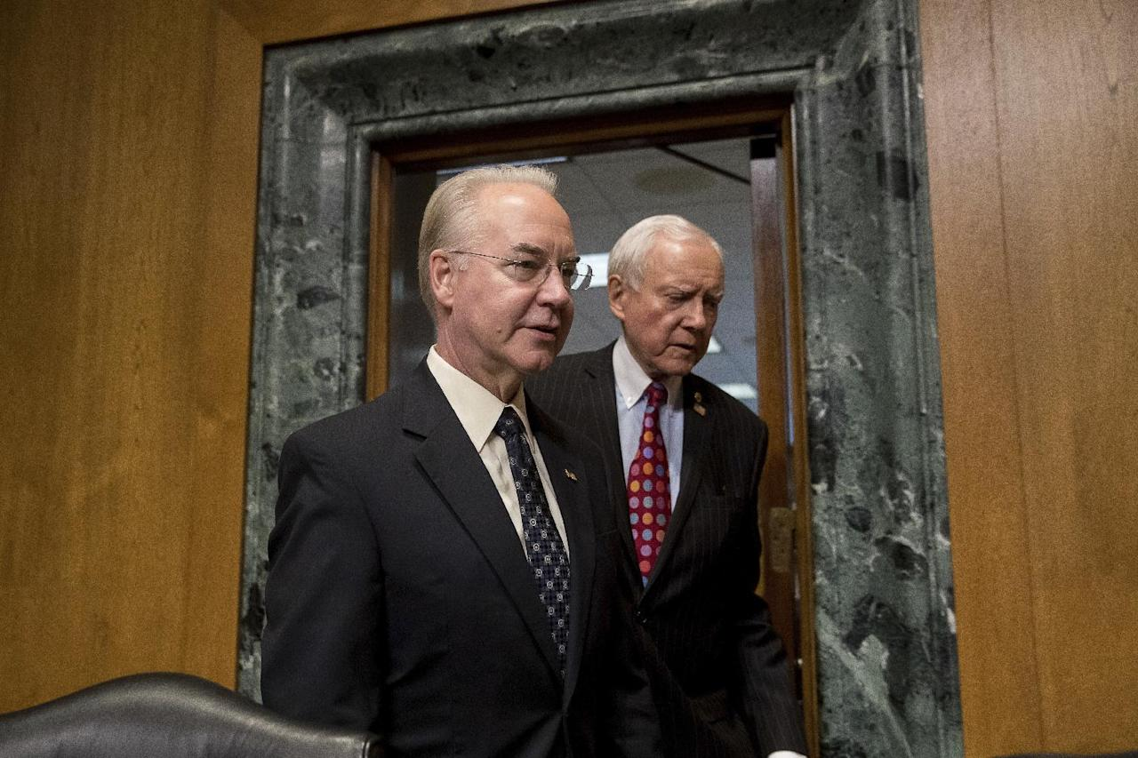 Senate Finance Committee Chairman Sen. Orrin Hatch, R-Utah, right, escorts Health and Human Services Secretary-designate, Rep. Tom Price, R-Ga. on Capitol Hill in Washington, Tuesday, Jan. 24, 2017, prior to the start of the committee's confirmation hearing for Price. Price is backed by Republicans but under fire from Democrats for his support for tearing down Obama's health care overhaul and his past stock trades. (AP Photo/Andrew Harnik)