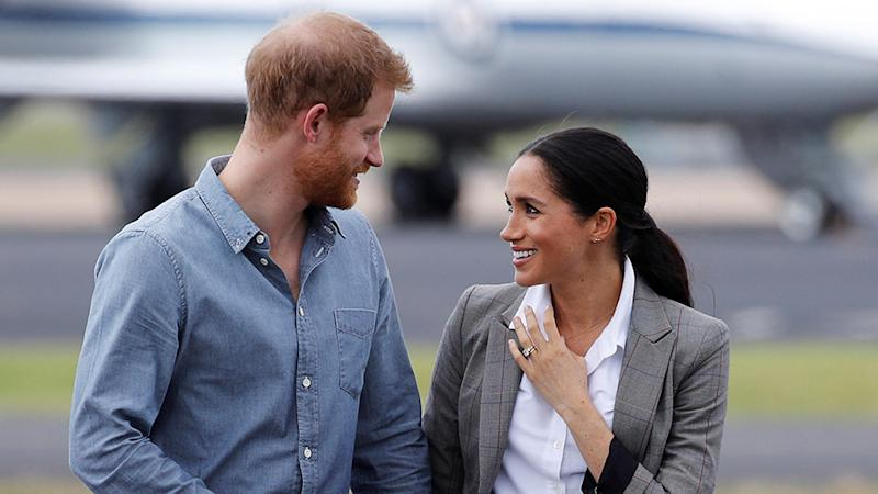 Prince Harry and Meghan Markle look at each other