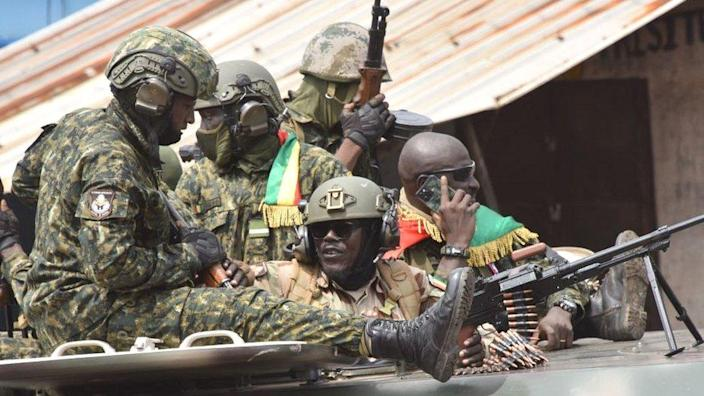 Soldiers on top of military vehicle in Conakry