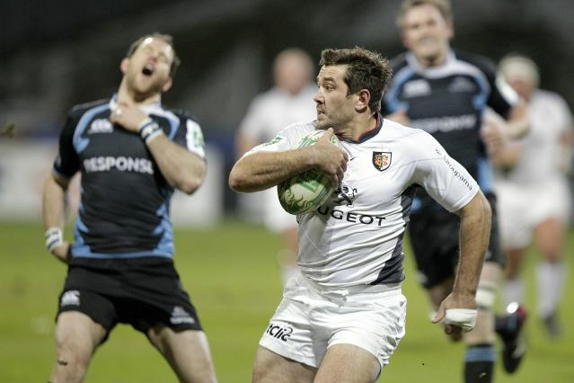Toulouse's Florian Fritz (C) scores a try despite Glasgow Warriors' Graeme Morrison (L) during their Heineken Cup, pool six, rugby union match at Firhill Stadium in Glasgow on December 10, 2010. AFP PHOTO / GRAHAM STUART (Photo credit should read GRAHAM STUART/AFP/Getty Images)