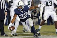 Penn State running back Akeel Lynch (22) celebrates in the end zone after scoring on a 3-yard run during the second half of an NCAA college football game against Michigan State in State College, Pa., Saturday, Nov. 29, 2014. (AP Photo/Gene J. Puskar)