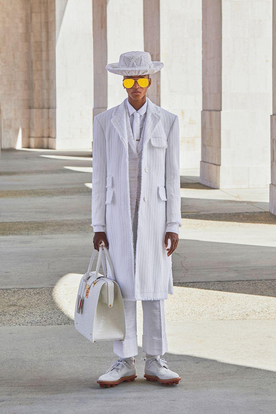 "<p>Some designers were prepping for life at home, while others, like the always-imaginative Thom Browne, were dreaming of days spent 239,000 miles above the earth. The setting was ""the first lunar games … in a coliseum on the moon,"" of course. The all cream-and-white collection was made up of tailored, sporty looks in wool, seersucker, cotton, and cashmere. Long pleated skirts, vests, cropped trousers, and top coats felt as much like throwbacks as they did futuristic pieces. Hey, anytime except the present sounds like a plan to us. —<em>Kerry Pieri</em></p>"