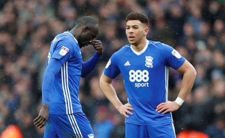 Soccer Football - Championship - Aston Villa vs Birmingham City - VIlla Park, Birmingham, Britain - February 11, 2018 Birmingham City's Cheick Ndoye (L) walks off dejected after being sent off Action Images/Matthew Childs