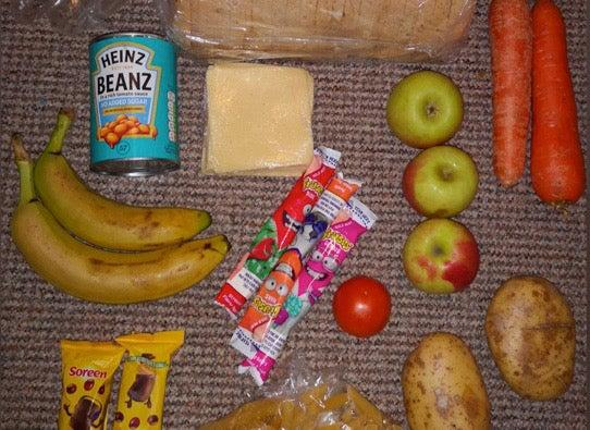 A photo shows the food parcel received by one parent during lockdown (Twitter/Roadside Mum)