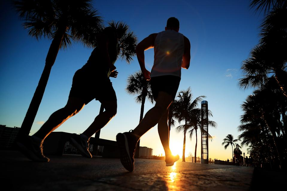 MIAMI BEACH, FL - MARCH 18: People exercise in South Pointe Park on March 18, 2020 in Miami Beach, Florida. Miami Beach city officials closed the area of the beach that is popular with college spring breakers and asked them to refrain from large gatherings where COVID-19 could spread.  (Photo by Cliff Hawkins/Getty Images)