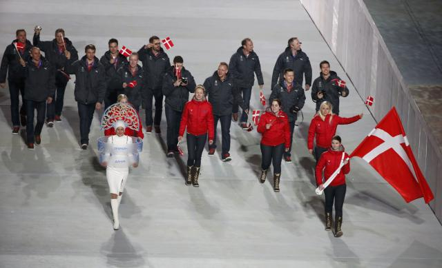Denmark's flag-bearer Lene Nielsen leads her country's contingent during the opening ceremony of the 2014 Sochi Winter Olympics, February 7, 2014. REUTERS/Lucy Nicholson (RUSSIA - Tags: OLYMPICS SPORT)