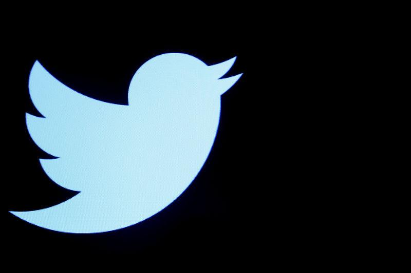 The Twitter logo is displayed on a screen on the floor of the NYSE