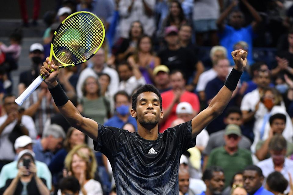 Felix Auger-Aliassime (pictured) raises his hands in celebration at the US Open.