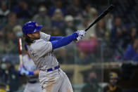 Chicago Cubs' Jake Marisnick hits a single during the fourth inning of a baseball game against the San Diego Padres, Monday, June 7, 2021, in San Diego. Cubs' Anthony Rizzo and Kris Bryant scored off a throwing error by San Diego Padres starting pitcher Ryan Weathers on the play. (AP Photo/Gregory Bull)
