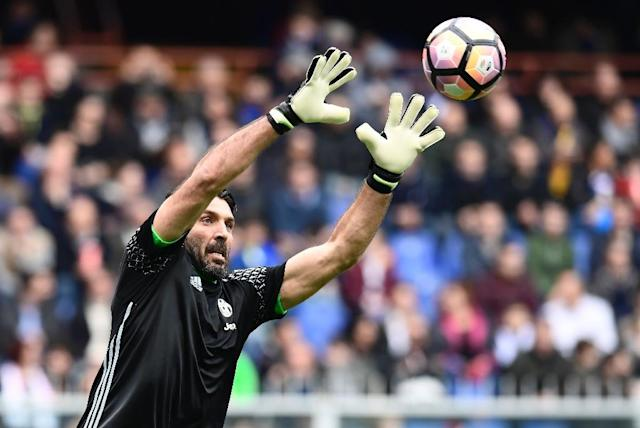 Juventus' Italian goalkeeper Gianluigi Buffon made his professional debut in 1995 as a 17-year-old in goal for Parma and has gone on to become a football icon at home and abroad (AFP Photo/MIGUEL MEDINA)