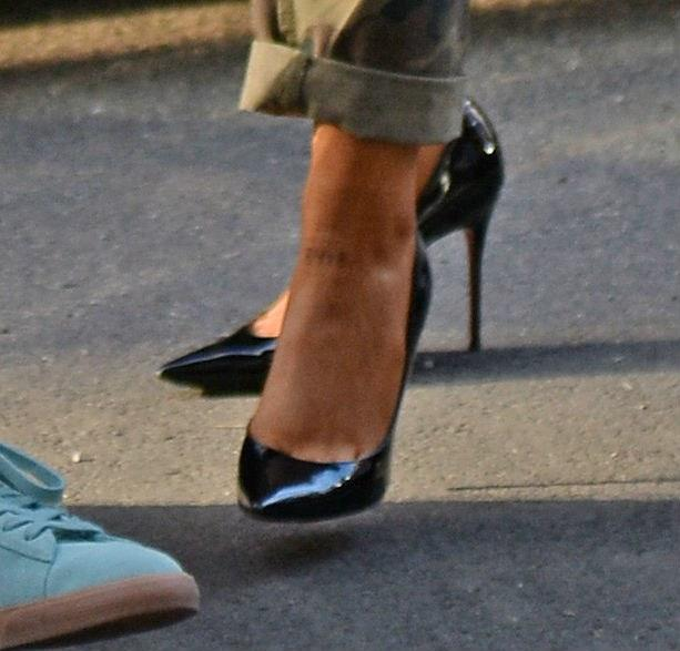 Look closely for what appears to be '8418' tattooed on Grande's foot.