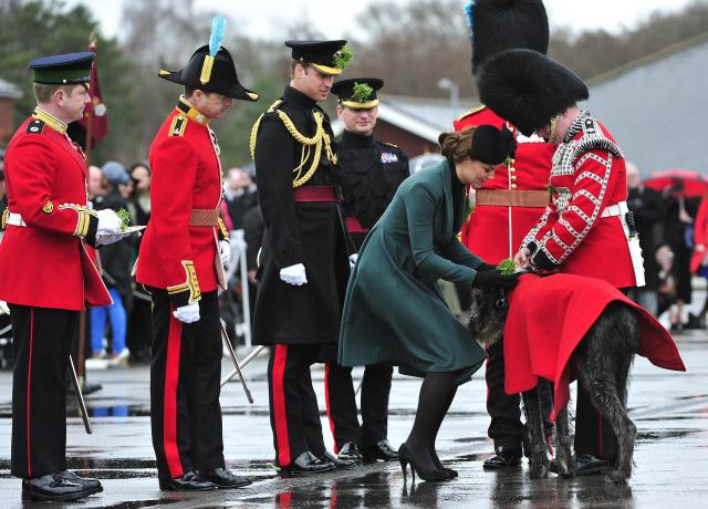 ALDERSHOT, ENGLAND - MARCH 17: Prince William, Duke of Cambridge and Catherine, Duchess of Cambridge attend a St Patrick's Day parade by the 1st Battalion Irish Guards as they visit Aldershot Barracks on St Patrick's Day on March 17, 2013 in Aldershot, England. (Photo by Toby Melville - WPA Pool/Getty Images)