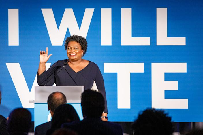 Former minority leader of the Georgia House of Representatives Stacey Abrams speaks to a crowd at a Democratic National Committee event at Flourish in Atlanta on June 6, 2019 in Atlanta, Georgia.