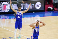 Philadelphia 76ers' Ben Simmons (25) and Furkan Korkmaz (30) react after a foul call during the first half of Game 5 in a first-round NBA basketball playoff series against the Washington Wizards, Wednesday, June 2, 2021, in Philadelphia. (AP Photo/Matt Slocum)