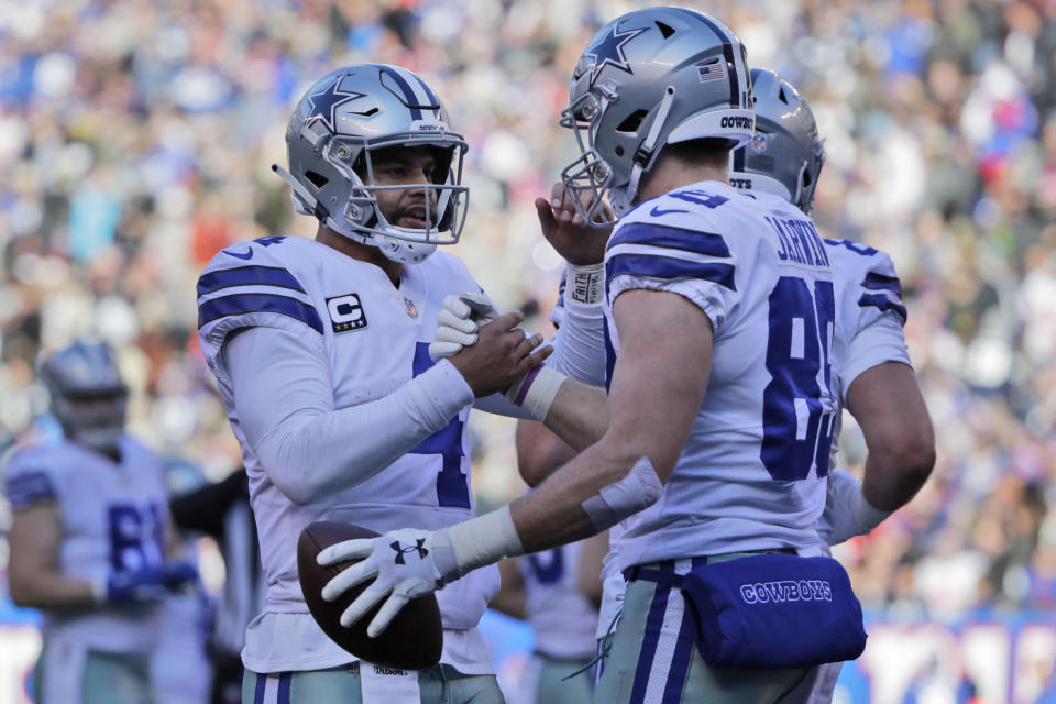 Dallas Cowboys quarterback Dak Prescott, left, and Blake Jarwin celebrate their touchdown during the first half of an NFL football game against the New York Giants, Sunday, Dec. 30, 2018, in East Rutherford, N.J. (AP Photo/Frank Franklin II)