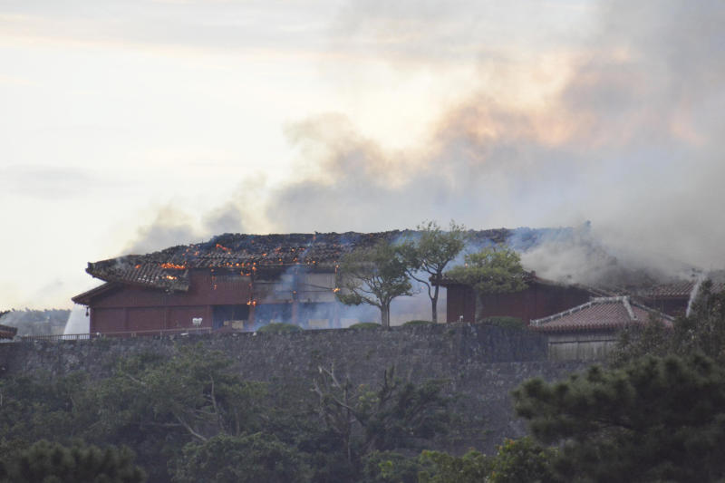 Smoke rises from the burning north hall of Shuri Castle in Naha, Okinawa, southern Japan, Thursday, Oct. 31, 2019. A fire spread among structures at Shuri Castle on Japan's southern island of Okinawa, nearly destroying the UNESCO World Heritage site. (Tomomi Tomita/Kyodo News via AP)