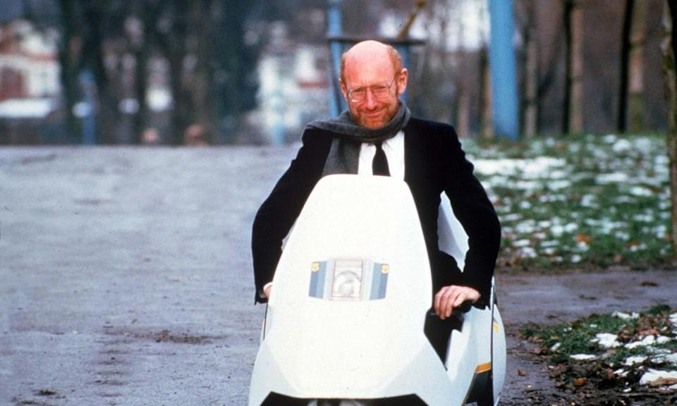 Sir Clive Sinclair on his Sinclair C5 vehicle.