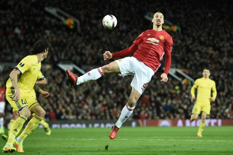Manchester United's Zlatan Ibrahimovic (C) jumps for the ball during their UEFA Europa League match against FC Rostov, at Old Trafford in Manchester, on March 16, 2017
