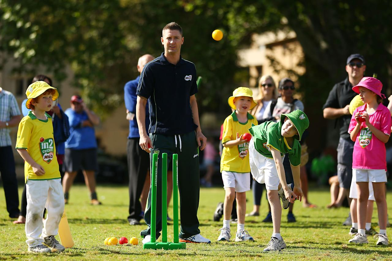 SYDNEY, AUSTRALIA - SEPTEMBER 30:  Michael Clarke plays cricket with young participants during the launch for Cricket Australia's junior sports program MILO in2CRICKET at Rushcutters Bay Park on September 30, 2013 in Sydney, Australia.  (Photo by Matt King/Getty Images)