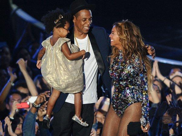 JAY-Z and his wife Beyoncé with their daughter Blue Ivy (Photo by Jason LaVeris/FilmMagic)