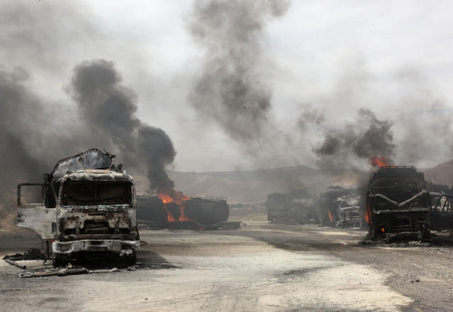 <p>Smoke rises from burning NATO supply trucks in Samangan province, July 18, 2012. A bomb planted by the Taliban destroyed 22 NATO trucks carrying supplies to their forces in northern Afghanistan. (Photo: Stringer/Reuters) </p>