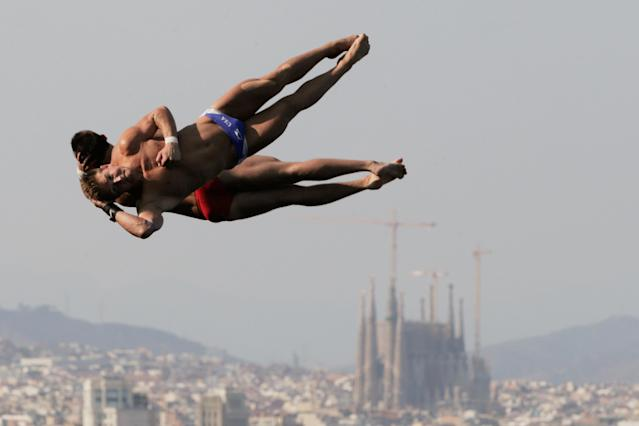 BARCELONA, SPAIN - JULY 21: Toby Stanley and David Bonuchi of USA compete in the Men's 10m Platform Synchronised Diving final on day two of the 15th FINA World Championships at Piscina Municipal de Montjuic on July 21, 2013 in Barcelona, Spain. (Photo by Adam Pretty/Getty Images)