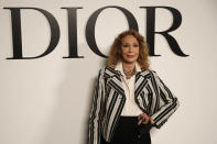 Actress Marisa Berenson poses before Dior's Spring-Summer 2021 fashion collection Tuesday, Sept. 29, 2020 before the show during the Paris fashion week. (AP Photo/Francois Mori)