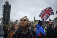 LONDON, ENGLAND - OCTOBER 24: Protesters are seen in Parliament Square during a Unite for Freedom march on October 24, 2020 in London, England. Hundreds of anti-mask and anti-lockdown protesters marched through central London, England demonstrating against latest Coronavirus lockdown measures. (Photo by Peter Summers/Getty Images)