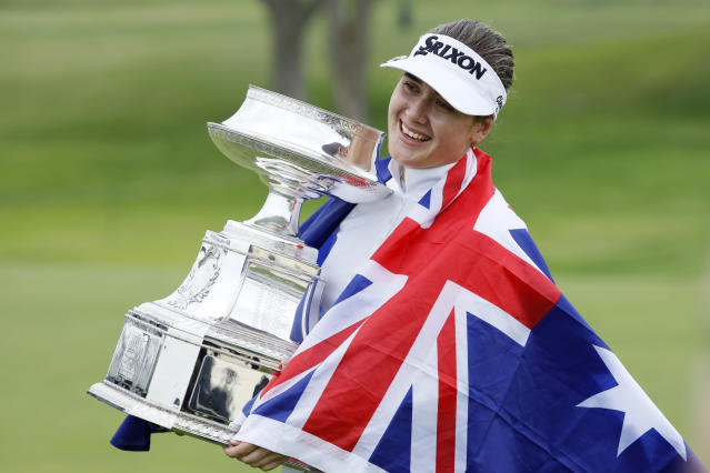Hannah Green, of Australia, holds the trophy after winning the KPMG Women's PGA Championship golf tournament, Sunday, June 23, 2019, in Chaska, Minn. (AP Photo/Charlie Neibergall)