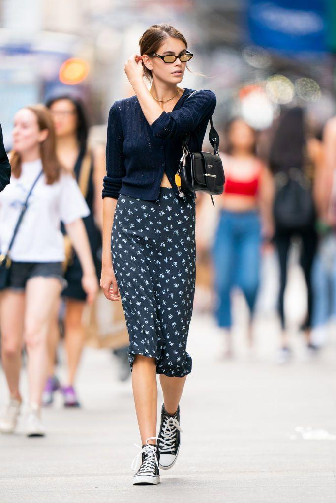 <p>Gerber opted for a '90s look in Converse trainers, a slip skirt and cropped cardigan. </p>