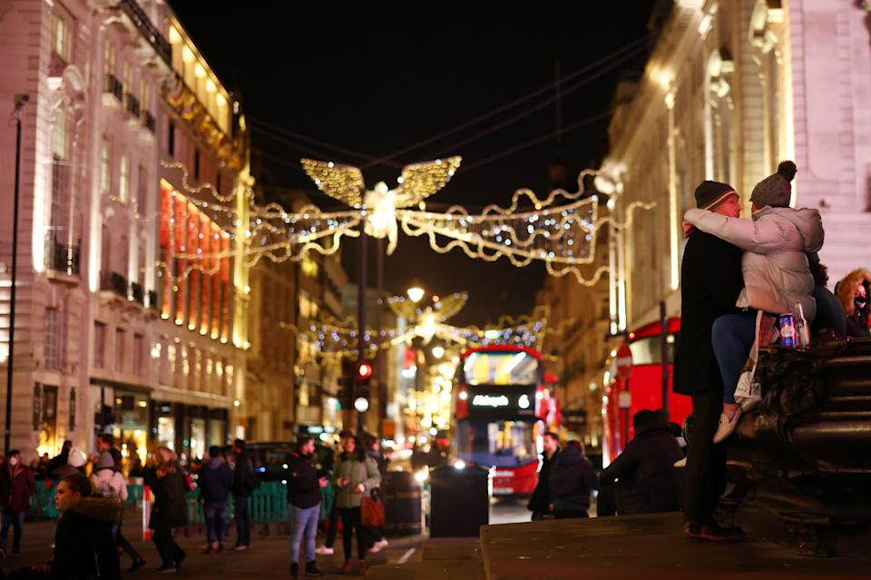 <p>Christmas shoppers seen in Piccadilly Circus</p> (REUTERS)