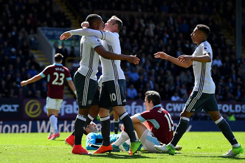 United goalscorers Martial and Rooney celebrate at Turf Moor: Getty Images