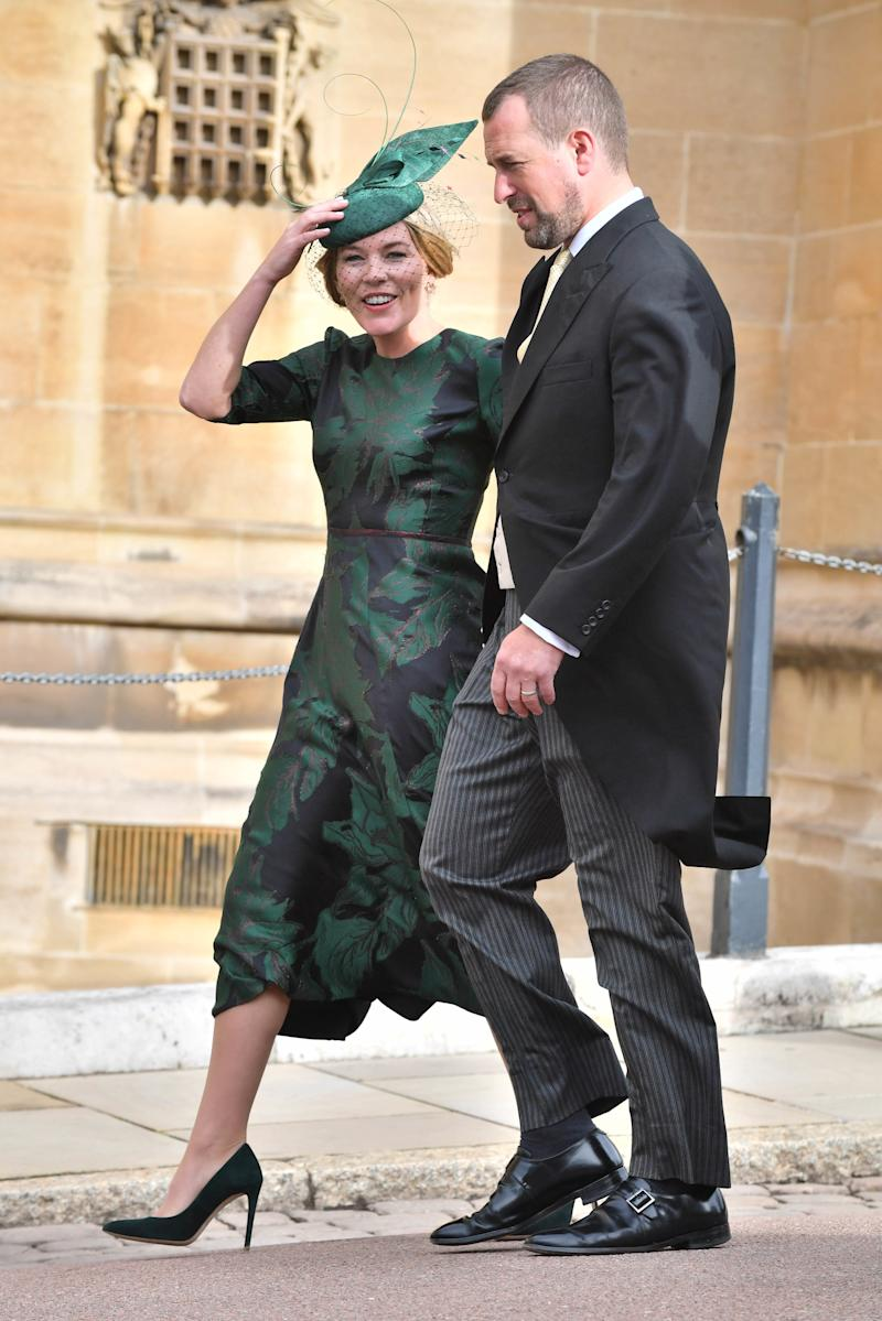 Peter Phillips and Autumn Phillips attend the wedding of Princess Eugenie of York to Jack Brooksbank at St. George's Chapel on October 12, 2018, in Windsor, England.