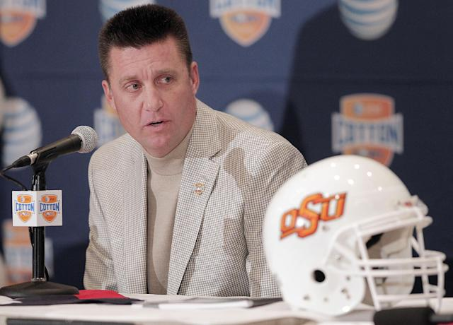 Oklahoma State head football coach Mike Gundy speaks to the media during an NCAA college football news conference, Thursday, Jan. 2, 2014, in Irving, Texas. Oklahoma State will play Missouri in the Cotton Bowl on Friday in Arlington, Texas. (AP Photo/Brandon Wade)