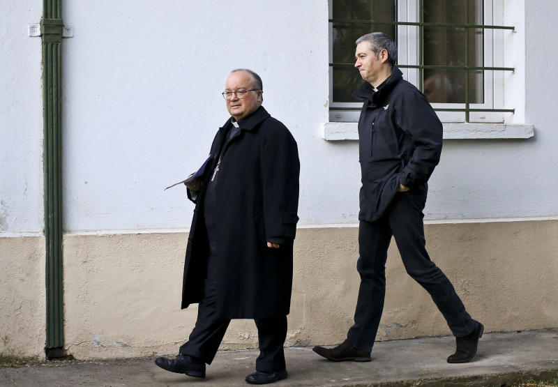 FILE - In this June 19, 2018 file photo, Archbishop Charles Scicluna, left, and Spanish Monsignor Jordi Bertomeu, right, walk in for a press conference, in Santiago, Chile. The Vatican announced Monday, March 2, 2020, that is sending Scicluna and Bertomeu, its top two sex crimes investigators, to Mexico on a fact-finding and assistance mission. (AP Photo/Esteban Felix, File)