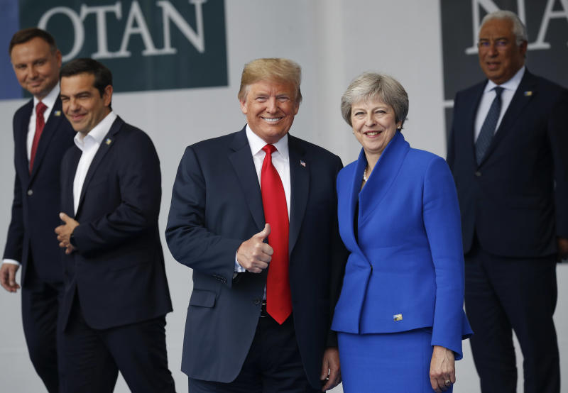 The Latest: May says Trump-Putin talks could reduce tensions