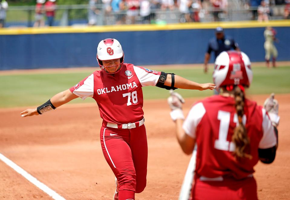Oklahoma's Jocelyn Alo (78) celebrates a home run with Nicole Mendes (11) in the first inning during the final game of Women's College World Series championship series between University of Oklahoma (OU) and Florida State University at the USA Softball Hall of Fame Stadium in Oklahoma City, Thursday, June 10, 2021.