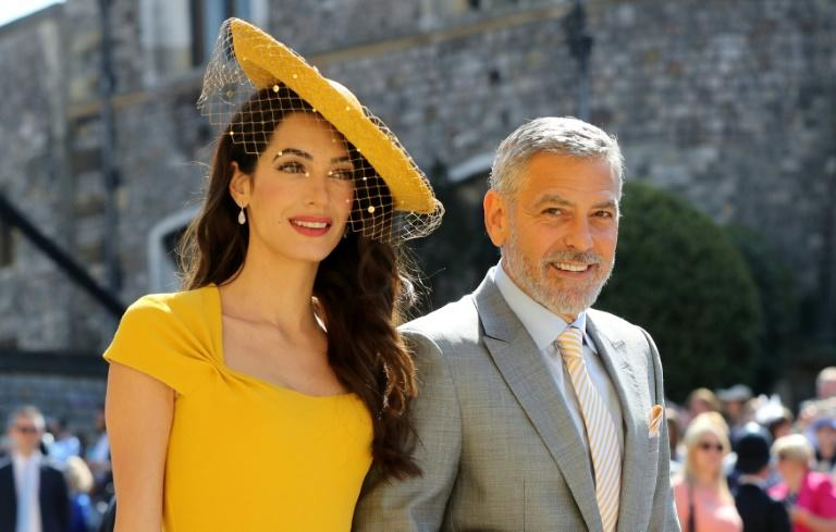 Amal Clooney and US actor George Clooney arrive for the wedding at Windsor Castle