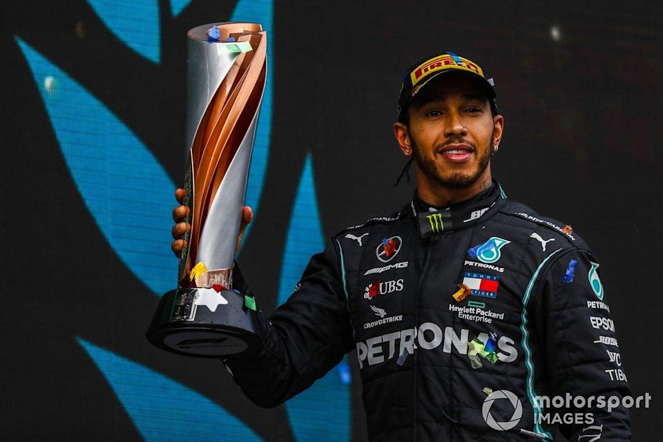 """Lewis Hamilton, Mercedes-AMG F1, 1st position, with his trophy<span class=""""copyright"""">Charles Coates / Motorsport Images</span>"""