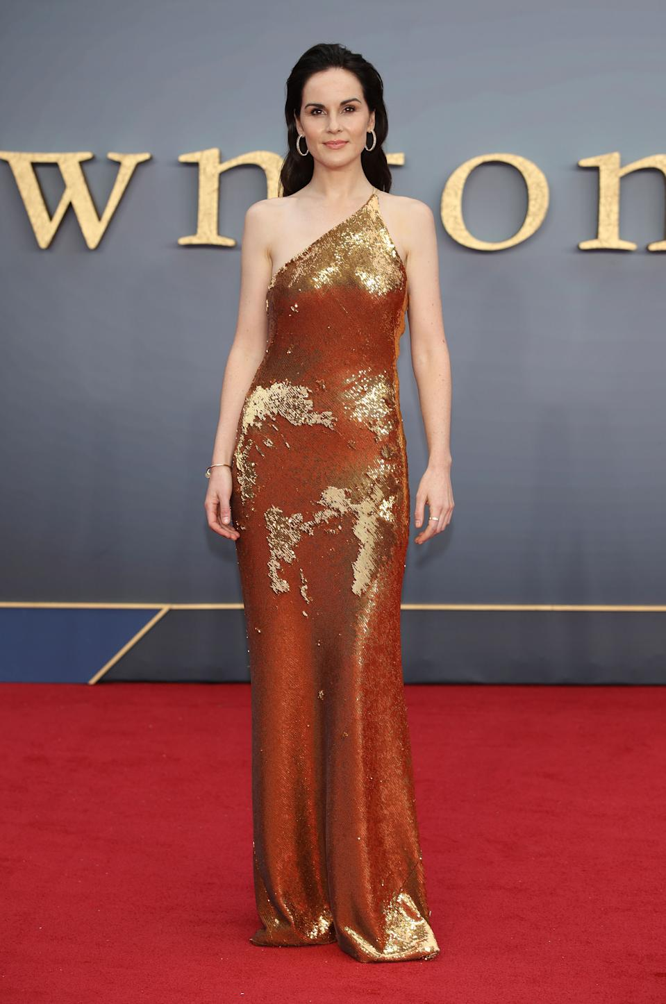 Michelle Dockery attends glitters in gold in a Galvan London gown [Photo: Getty Images]