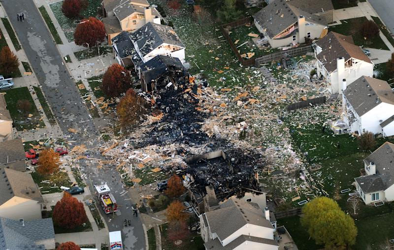 This aerial photo shows the two homes that were leveled and the numerous neighboring homes that were damaged from a massive explosion that sparked a huge fire and killed two people, Sunday, Nov. 11, 2012, in Indianapolis.  Nearly three dozen homes were damaged or destroyed, and seven people were taken to a hospital with injuries authorities said Sunday. The powerful nighttime blast shattered windows, crumpled walls and could be felt at least three miles away. (AP Photo/The Indianapolis Star, Matt Kryger)  NO SALES