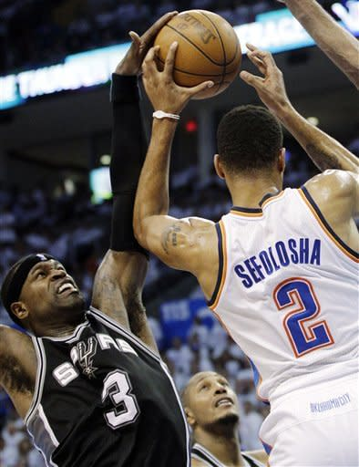 San Antonio Spurs shooting guard Stephen Jackson (3) blocks a shot by Oklahoma City Thunder shooting guard Thabo Sefolosha (2), of Switzerland, during the first half of Game 6 in the NBA basketball Western Conference finals, Wednesday, June 6, 2012, in Oklahoma City. (AP Photo/Sue Ogrocki)