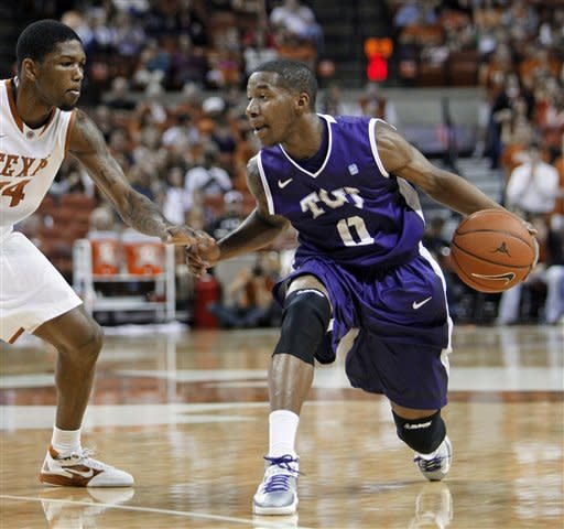 TCU guard Charles HIll, Jr. right, looks to drive around Texas guard Julien Lewis during the first half of an NCAA college basketball game, Saturday, Feb. 2, 2013, in Austin, Texas. (AP Photo/Michael Thomas)