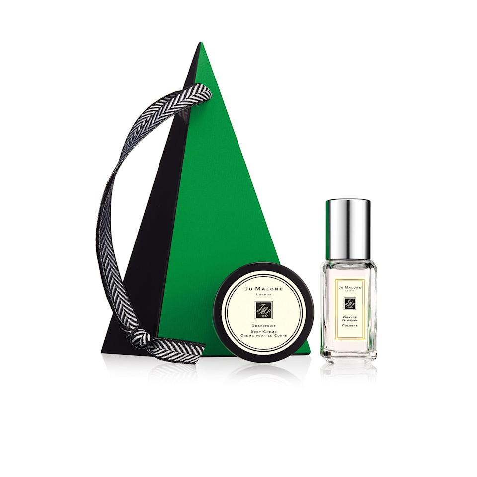 """<p><a rel=""""nofollow noopener"""" href=""""https://www.jomalone.co.uk/"""" target=""""_blank"""" data-ylk=""""slk:Jo Malone"""" class=""""link rapid-noclick-resp"""">Jo Malone</a> - £22</p><p>Christmas tree decorations don't get any more chic than this! Jo Malone's forest green pyramid houses a mini Grapefruit Crème Pour le Corps <em>and </em>a 9ml Orange Blossom Cologne making it the perfect stocking filler for any fragrance-obsessive. Or an amazing gift for yourself...</p>"""
