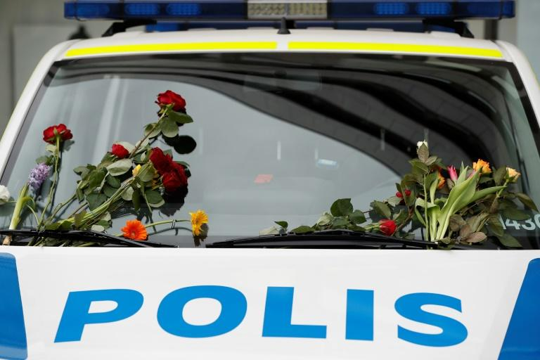 A police car parked near the scene of the attack has been decorated with flowers