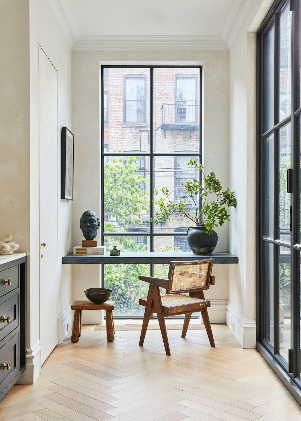 <p>With gorgeous custom steel-frame windows flooding the room with light, it'd be pretty hard not to feel inspired here. If there's a spare nook in a light-filled hallway, kitchen, or mudroom, consider customizing a floating desk for a clean, minimal look that still provides plenty of space to spread out and hunker down. </p>