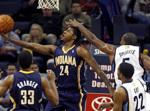 Memphis Grizzlies forward Marreese Speights (5) defends against Indiana Pacers forward Paul George (24) in the first half of an NBA basketball game on Friday, Feb. 10, 2012, in Memphis, Tenn. (AP Photo/Alan Spearman)